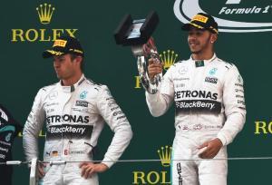 Hamilton celebrating Chinese GP Victory as Rosberg fumes - credit citizen.co.za