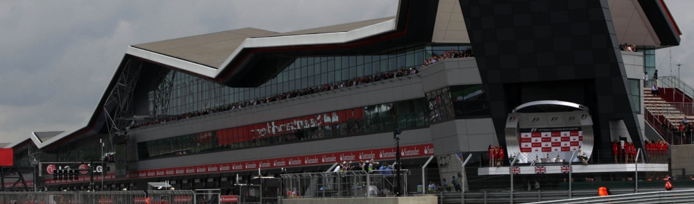 Mark Webber in front of the Silverstone wing, 2012 - Copyright: Silverstone Circuit