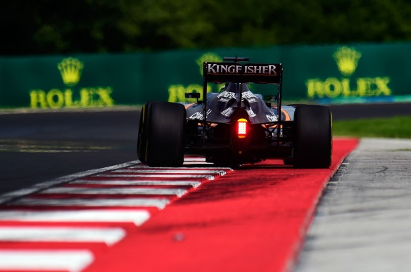 Nico Hulkenberg running over the Hungaroring kerbs. Copyright: Force India F1 team