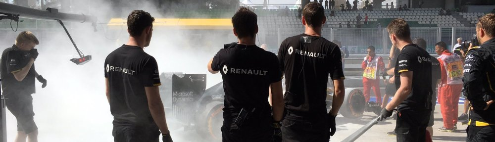 Renault crew look on at Magnussen's burning car. Copyright: Renault Sport F1.
