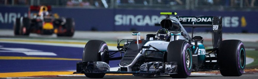 Nico Rosberg leads Ricciardo in the Singapore Grand Prix. Copyright: Mercedes AMG F1 Team.