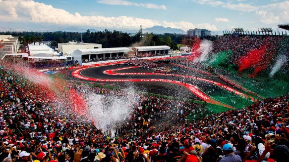 The stadium bursts with colour for the Mexican GP podium celebrations. Copyright Red Bull Racing.