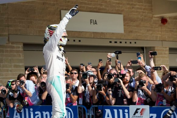 Lewis Hamilton celebrates 2016 USGP victory. Copyright Mercedes AMG F1 Team