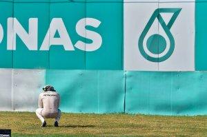 Hamilton squats aside the track. Copyright Mercedes AMG F1 Team.