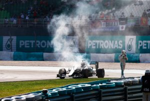 Lewis Hamilton walks away from his smoking car. Copyright Mercedes AMG F1 Team.