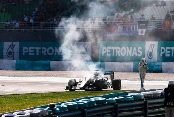 hamilton-walking-away-from-smoking-car-c-mercedes