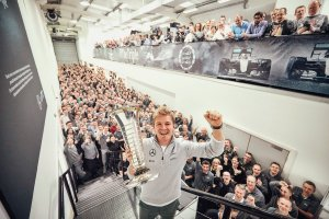 Nico Rosberg with the Formula One Drivers' Championship Trophy at the Mercedes Brackley factory. Copyright: Nico Rosberg