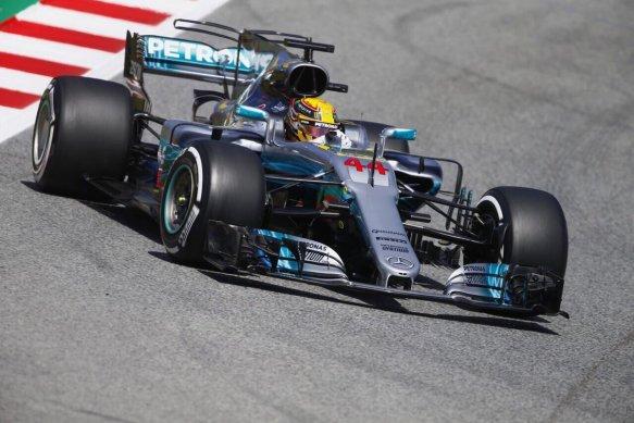 Lewis Hamilton clinching pole for the Spanish Grand Prix.