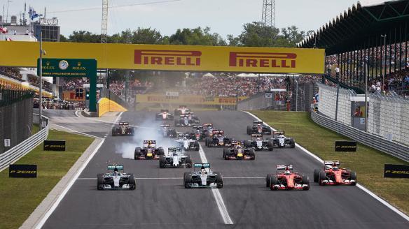 2015 Hungarian GP start - Rosberg, Hamilton, Raikkonen, Vettel 4 wide - https-::www.mercedesamgf1.com:en:mercedes-amg-f1:gallery-the-silver-arrows-at-the-hungarian-grand-prix: