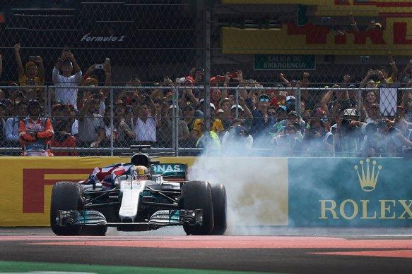 Hamilton celebrates 2017 title Mexico GP - https-::twitter.com:MercedesAMGF1:status:924821621491355648